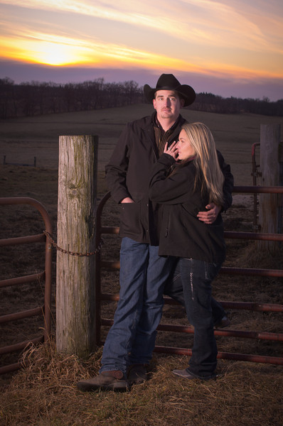 Couple at sunset during winter engagement photos at a family ranch near Severson Dells in Rockford, IL