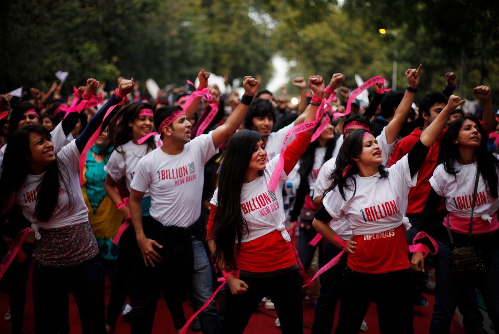 ". Activists dance in an event to support ""One Billion Rising\"" global campaign in New Delhi, India, Thursday, Feb. 14, 2013. Flashmobs and rallies with singing and dancing were organized across the country as part of the campaign, timed to coincide with Valentine\'s Day, to bring an end to violence against women. (AP Photo/Altaf Qadri)"