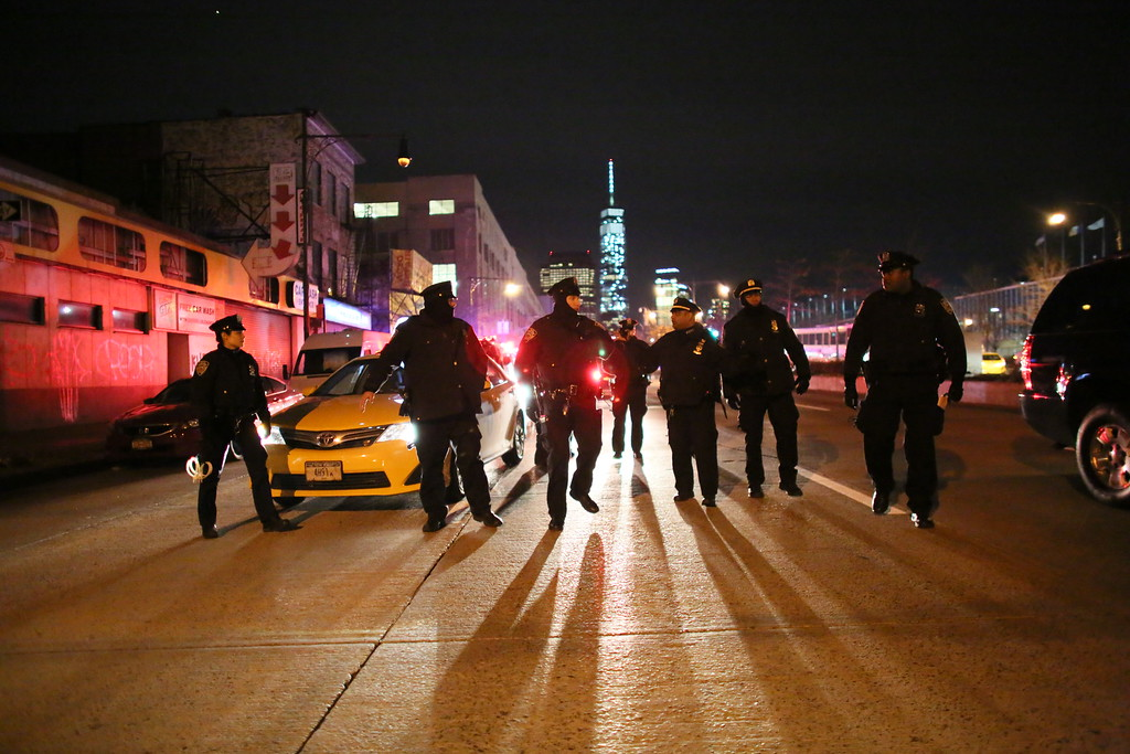 . Police gather on the West Side Highway during a protest December 4, 2014 in New York. Protests began after a Grand Jury decided to not indict officer Daniel Pantaleo. Eric Garner died after being put in a chokehold by Pantaleo on July 17, 2014. Pantaleo had suspected Garner of selling untaxed cigarettes. (Photo by Yana Paskova/Getty Images)