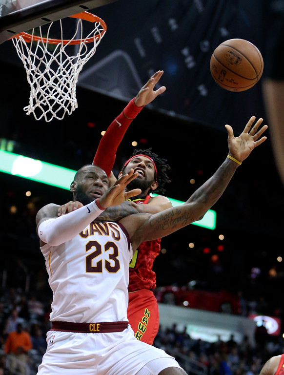 . Cleveland Cavaliers forward LeBron James (23) is defended by Atlanta Hawks forward DeAndre\' Bembry (95) as he goes to the basket in the second half of an NBA basketball game Thursday, Nov. 30, 2017, in Atlanta. Cleveland won 121-114. (AP Photo/John Bazemore)