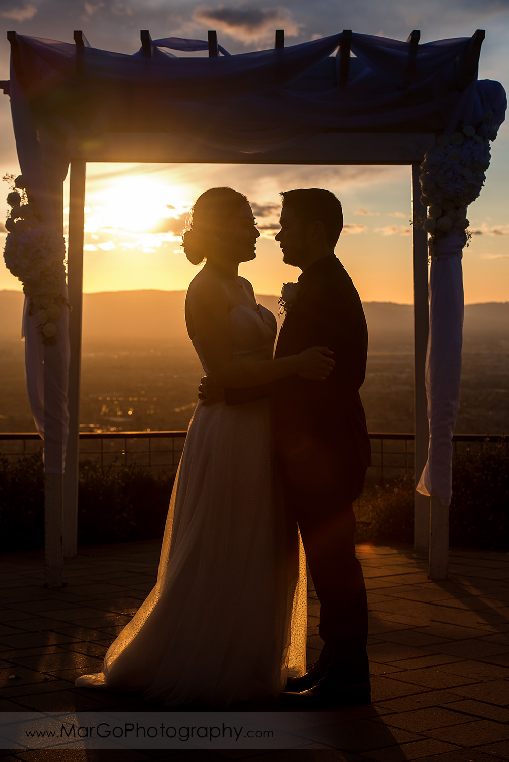 sunset silhouette of bride and groom at Mt Hamilton GrandView Restaurant in San Jose