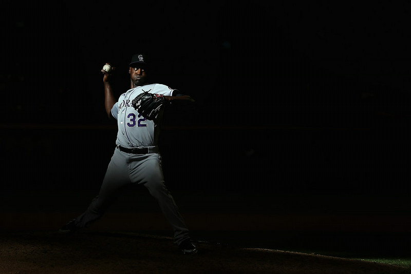. Relief pitcher LaTroy Hawkins #32 of the Colorado Rockies pitches against the Arizona Diamondbacks during the tenth inning of the MLB game at Chase Field on August 10, 2014 in Phoenix, Arizona.  The Rockies defeated the Diamondbacks 5-3 in 10 innings.  (Photo by Christian Petersen/Getty Images)