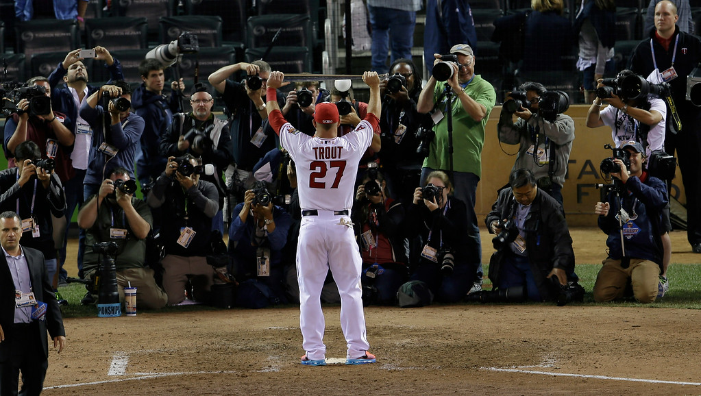 . American League outfielder Mike Trout, of the Los Angeles Angels, holds the MVP trophy after his team\'s 5-3 victory over the National League in the MLB All-Star baseball game, Tuesday, July 15, 2014, in Minneapolis. (AP Photo/Paul Sancya)