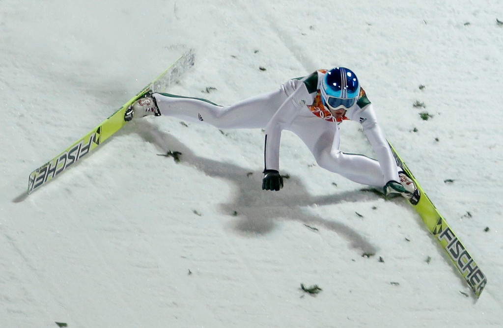 . Slovenia\'s Robert Kranjec falls during the men\'s normal hill ski jumping qualification at the 2014 Winter Olympics, Saturday, Feb. 8, 2014, in Krasnaya Polyana, Russia. (AP Photo/Gregorio Borgia)