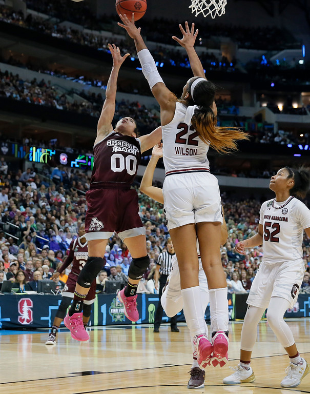 . Mississippi State guard Dominique Dillingham (00) has her shot blocked by South Carolina forward A\'ja Wilson (22) during the first half in the final of NCAA women\'s Final Four college basketball tournament, Sunday, April 2, 2017, in Dallas. (AP Photo/Tony Gutierrez)