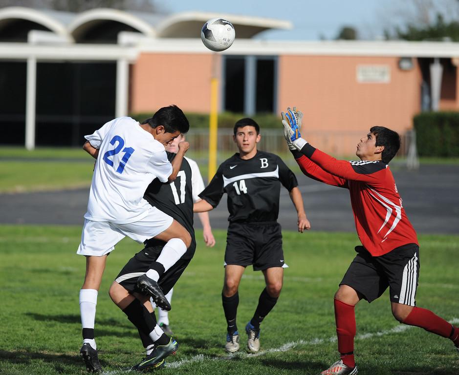 . 02-15-2012--(LANG Staff Photo by Sean Hiller)- Los Alamitos beat Buena 4-1 in the first round of the Division 1 boys soccer playoffs Friday at Laurel School in Los Alamitos. Luis Manzano attempts a goal against Buena\'s goal keeper Martinez Matt.