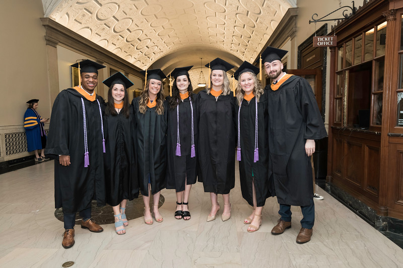 l-r: Corey Parker, Katelyn Battaglia, Keri Bresnahan, Margot Ranieri, Lauren Gotsch, Giovanna O'Neil and Brett Kinsman pose for a photo in Lowry Hall before the ceremony. // University of Rochester School of Nursing Commencement, Kodak Hall at Eastman Theatre May 17, 2019.  // photo by J. Adam Fenster / University of Rochester