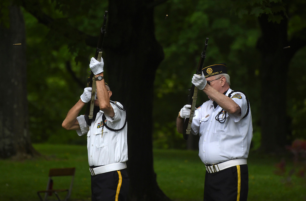 . Kayla Rice/Reformer Members of the Brattleboro VFW honor guard shoot their rifles into the air during the Memorial Day service at the Brattleboro Common on Monday morning.