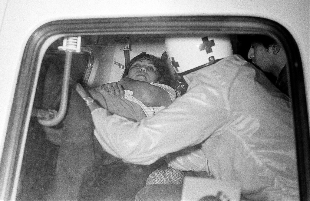 . Italian newswoman Oriana Fallaci lies on stretcher in ambulance as helmeted medical attendant looks on, during rioting in Mexico City between students and the army, Oct. 3, 1968. Many were wounded during the battle. (AP Photo/RF)