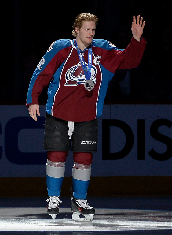 . Colorado Avalanche left wing Gabriel Landeskog (92) waves to the crowd after he was announced at a silver medalist in the 2014 Sochi Games before their game against the Los Angeles Kings February 27, 2014 at Pepsi Center. (Photo by John Leyba/The Denver Post)