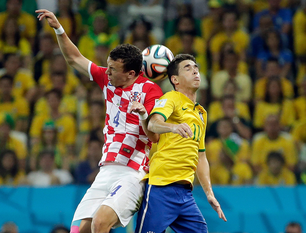 . Croatia\'s Ivan Perisic, left, and Brazil\'s Oscar battle for the ball during the group A World Cup soccer match between Brazil and Croatia, the opening game of the tournament, in the Itaquerao Stadium in Sao Paulo, Brazil, Thursday, June 12, 2014.  (AP Photo/Felipe Dana)