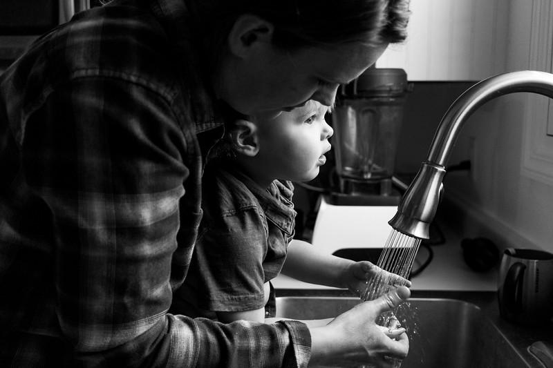 Mother washing child's hands.JPG