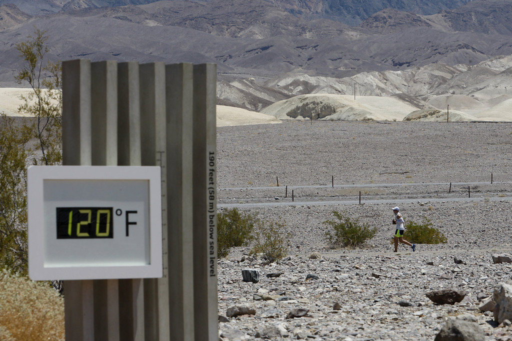 . A competitor passes the unofficial thermometer at Furnace Creek Visitor Center during the AdventurCORPS Badwater 135 ultra-marathon race on July 15, 2013 in Death Valley National Park, California. Billed as the toughest footrace in the world, the 36th annual Badwater 135 starts at Badwater Basin in Death Valley, 280 feet below sea level, where athletes begin a 135-mile non-stop run over three mountain ranges in extreme mid-summer desert heat to finish at 8,350 feet above sea level near Mount Whitney for a total cumulative vertical ascent of 13,000 feet. July 10 marked the 100-year anniversary of the all-time hottest world record temperature of 134 degrees, set in Death Valley where the average high in July is 116. A total of 96 competitors from 22 nations are attempting the run which equals about five back-to-back marathons. Previous winners have completed all 135 miles in slightly less than 24 hours.  (Photo by David McNew/Getty Images)
