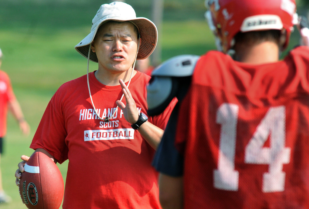 ". Assistant coach Elliott Vang gives instructions to his players during practice. ""The Hmong culture still doesn�t know much about American football,�� he said. �Many in the Hmong culture still think it is a recreational game. We want to teach these kids that once they have committed, they will learn all sorts of life lessons,\"" Vang said. (Pioneer Press: John Doman)"
