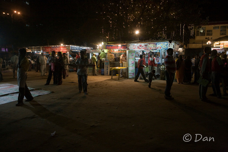 Street vendors with local food stalls at Chowpatty Beach.