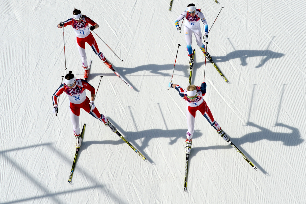 . Norway\'s Marit Bjoergen (front -L) and Norway\'s Therese Johaug (front R) are followed by Norway\'s Heidi Weng (4) and Sweden\'s Charlotte Kalla (6) as they compete in the Women\'s Cross-Country Skiing 30km Mass Start Free at the Laura Cross-Country Ski and Biathlon Center during the Sochi Winter Olympics on February 22, 2014, in Rosa Khutor, near Sochi.  (KIRILL KUDRYAVTSEV/AFP/Getty Images)