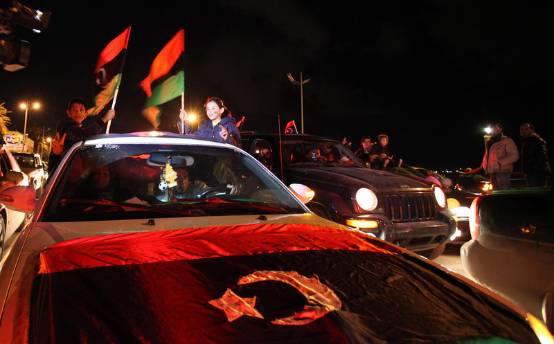 . Libyans wave the national flags during a celebration to commemorate the second anniversary of the revolution that ousted Moammar Gadhafi, in Benghazi, Libya, Friday, Feb, 15, 2013.  (AP Photo/Mohammad Hannon)