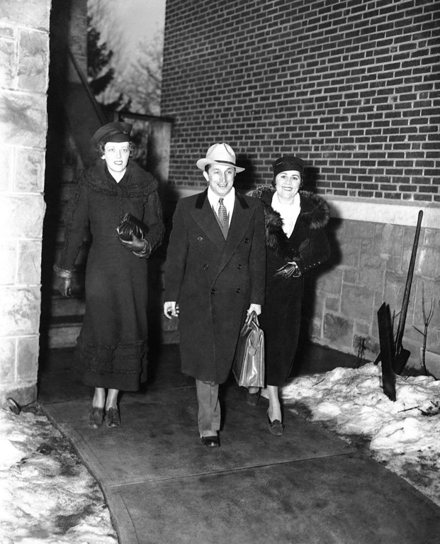 . New Jersey Attorney General David T. Wilentz arrives at the courthouse in Flemington, New Jersey, Jan. 21, 1935, for the opening of the fourth week of the trial of Bruno Richard Hauptmann, accused kidnap-killer of the Lindbergh baby. Accompanying him, at left, are Gertrude Maher Toolan, wife of state Senator John Toolan, and Lena Wilentz, wife of the attorney general. (AP Photo)