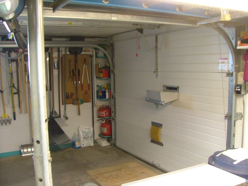 Garage door with mail slot. (dumps mail into sunroof as you drive in ;-)