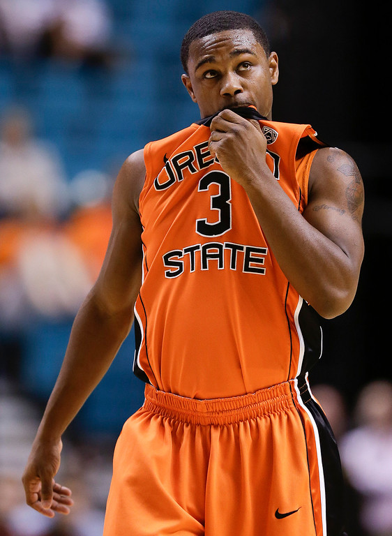 . Oregon State\'s Ahmad Starks looks at the scoreboard late in the second half against Colorado during a Pac-12 tournament NCAA college basketball game on Wednesday, March 13, 2013, in Las Vegas. Colorado won 74-68.(AP Photo/Julie Jacobson)