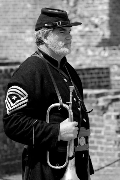 Reenactor Tom Smith, a principal musician bugler with the 1st S.C. Heavy Artillery, stands inside Ft. Sumter during a reenactment of the surrender ceremony in Charleston, South Carolina on Thursday, April 14, 2011. ..The 150th Anniversary of the Firing on Ft. Sumter was commemorated with lectures, performances, demonstrations, and a living history throughout the area on James Island, Charleston, Mt. Pleasant, and Sullivan's Island during the week from April 8-14, 2011. Photo Copyright 2011 Jason Barnette