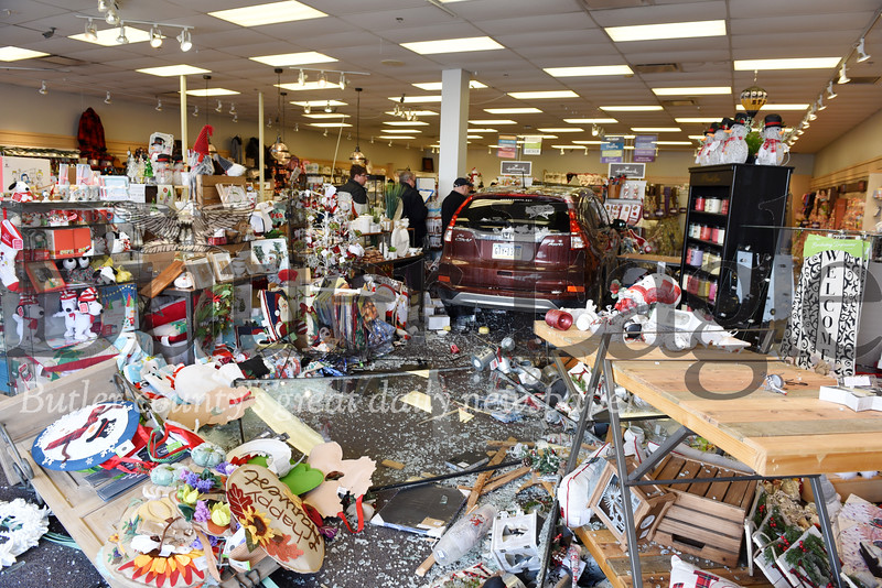 Harold Aughton/Butler Eagle: A woman drove her Honda Civic throught the window of the Hallmark store front at Butler Commons Wed., Nov. 13, 2019.