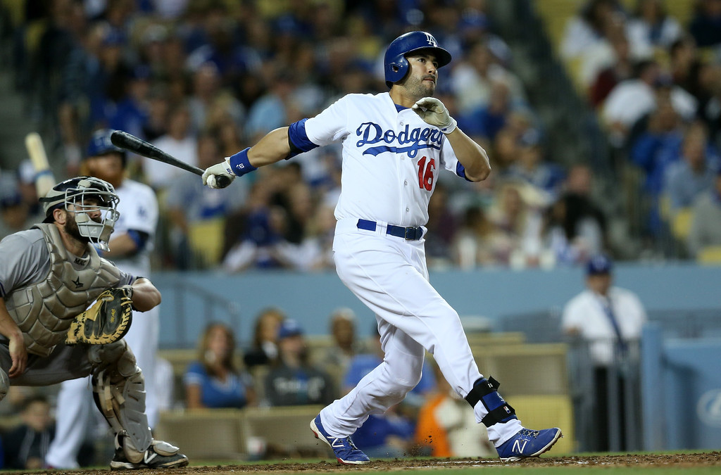 . Andre Ethier #16 of the Los Angeles Dodgers hits an RBI double in the fifth inning against the Colorado Rockies at Dodger Stadium on September 27, 2014 in Los Angeles, California.  (Photo by Stephen Dunn/Getty Images)