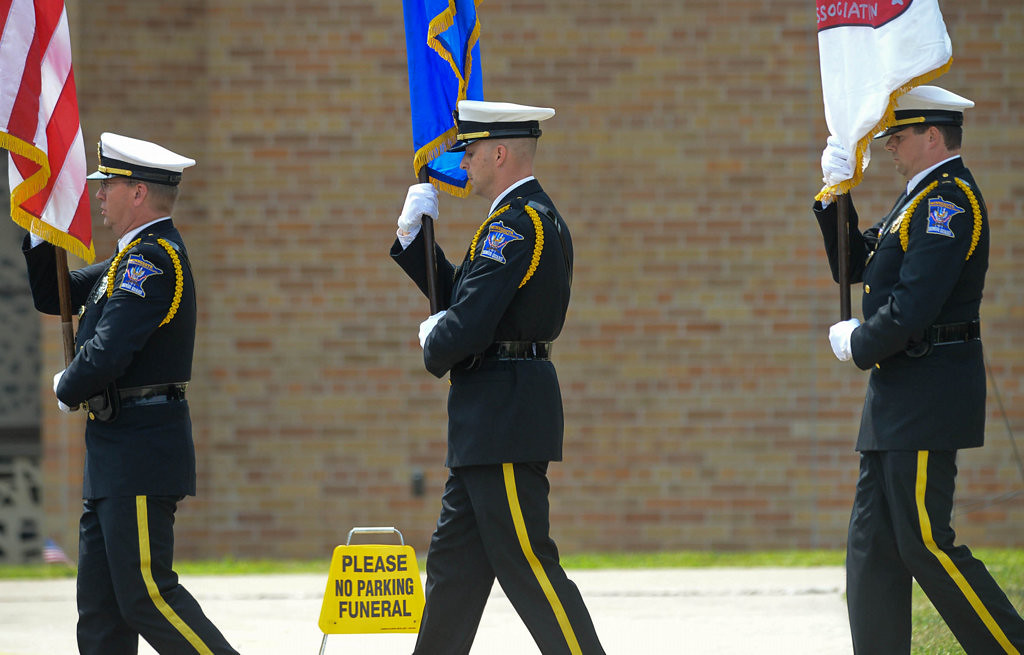 . Officers file past St. Stephen�s Lutheran Church in West St. Paul after the funeral service for fallen Mendota Heights officer Scott Patrick on Wednesday, August 6, 2014. (Pioneer Press: Ben Garvin)