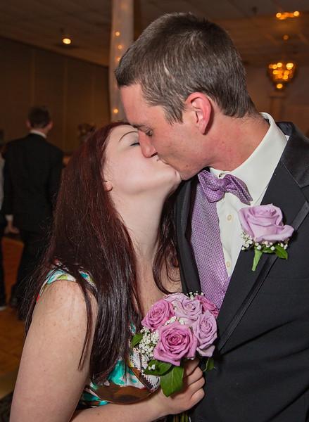 Bouquet and garter catch couple kissing.jpg