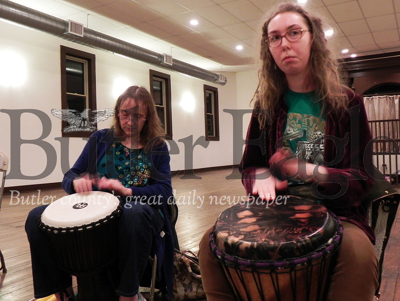 Beaver Falls residents Sherry, 58, and her daughter Elizabeth Allen, 20, play different beats on their drums Wednesday at the Harmony Drum and Dance Circle. Photo by Gabriella Canales.