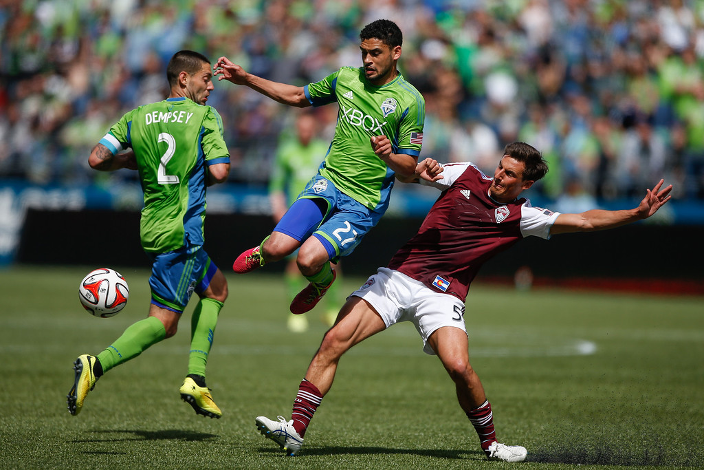 . Lamar Neagle #27 of the Seattle Sounders FC battles Thomas Piermayr #5 of the Colorado Rapids at CenturyLink Field on April 26, 2014 in Seattle, Washington. The Sounders defeated the Rapids 4-1.  (Photo by Otto Greule Jr/Getty Images)