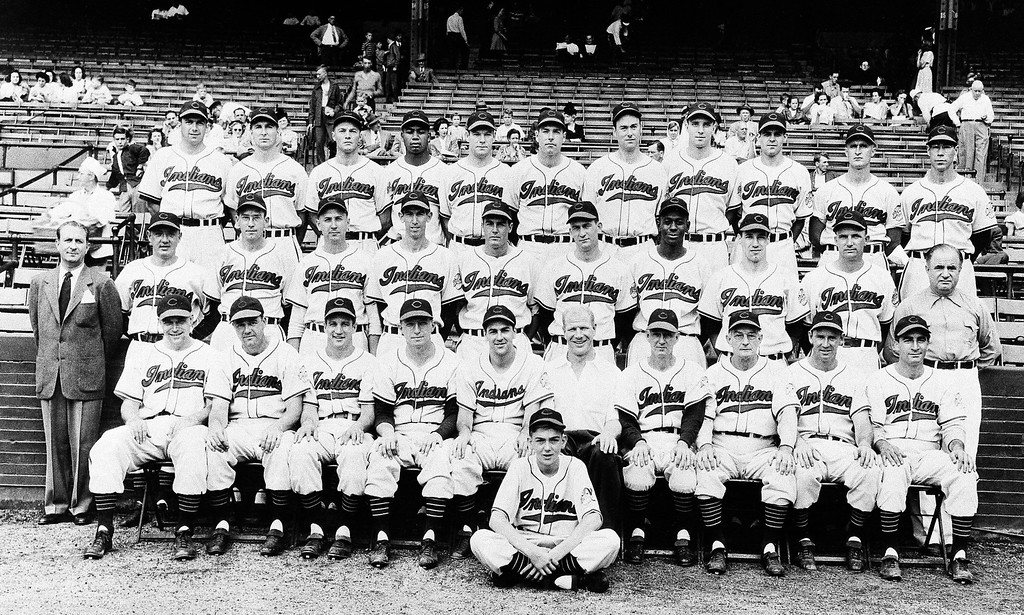 . The 1948 Indians is the most recent team picture of the Cleveland Indians on Oct. 3, 1948 in Cleveland. Front row left to right: Eddie Robinson, first base; Ken Keltner, third base; Al Rosen, third base; Mel Harder, Coach; Manager Lou Boudreau, shortstop; President Bill Veeck; Muddy Ruel, Coach; Bill McKechnie, Coach; Joe Gordon, second base; and Johnny Beradino, traveling secretary; Sam Zoldak, Ed Kleiman, Steve Gromek, Russ Christopher, Gene Bearden, Bob Lemon, Satchel Paige, Bob Feller, and Bob Muncriff (all pitchers); and Lefty Weisman, trainer. Top row: Walt Judnich, Allie Clark, Hal Peck, Larry Doby, Hank Edwards, Dale Mitchell, Bob Kennedy, all outfielders; Jim Hegan, catcher; Ray Boone, shortstop and catcher; Joe Tipton, catcher; and Thurman Tucker, outfielder. In front of group is. (AP Photo)
