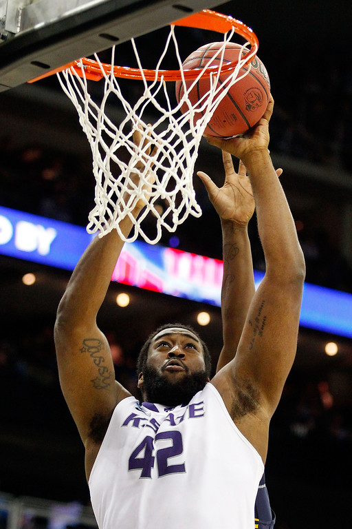 . KANSAS CITY, MO - MARCH 22: Thomas Gipson #42 of the Kansas State Wildcats shoots against the La Salle Explorers in the first half during the second round of the 2013 NCAA Men\'s Basketball Tournament at the Sprint Center on March 22, 2013 in Kansas City, Missouri.  (Photo by Ed Zurga/Getty Images)