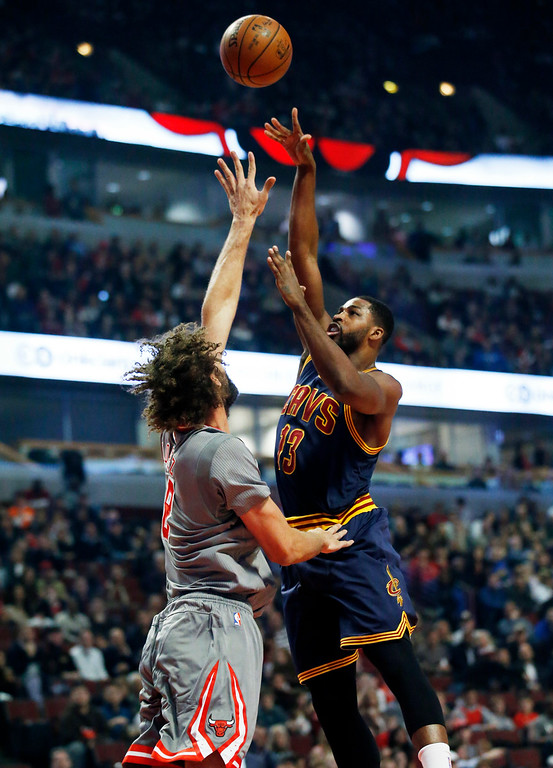 . Cleveland Cavaliers forward Tristan Thompson, right, shoots over Chicago Bulls center Robin Lopez during the first half of an NBA basketball game Friday, Dec. 2, 2016, in Chicago. (AP Photo/Nam Y. Huh)