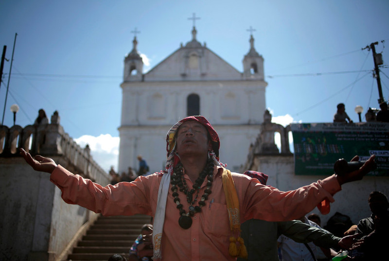 ". Carlos Tun, a Mayan priest, prays and participates in the pre-Hispanic mass of ""Primera Conexion\"" and \""Sincronizacion Espiritual\"" (First Connection and Spiritual Synchronization), to commemorate the 13th Baktun, outside the Chi Ixim church in Tactic, Alta Verapaz region, Guatemala, December 20, 2012. This week, at sunrise on Friday, December 21, an era closes in the Maya Long Count calendar, an event that has been likened by different groups to the end of days, the start of a new, more spiritual age or a good reason to hang out at old Maya temples across Mexico and Central America. The Chi Ixim church is a sacred Mayan site.  REUTERS/Jorge Dan Lopez"