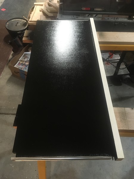 Shelf for stove, covered with rubberized undercoating