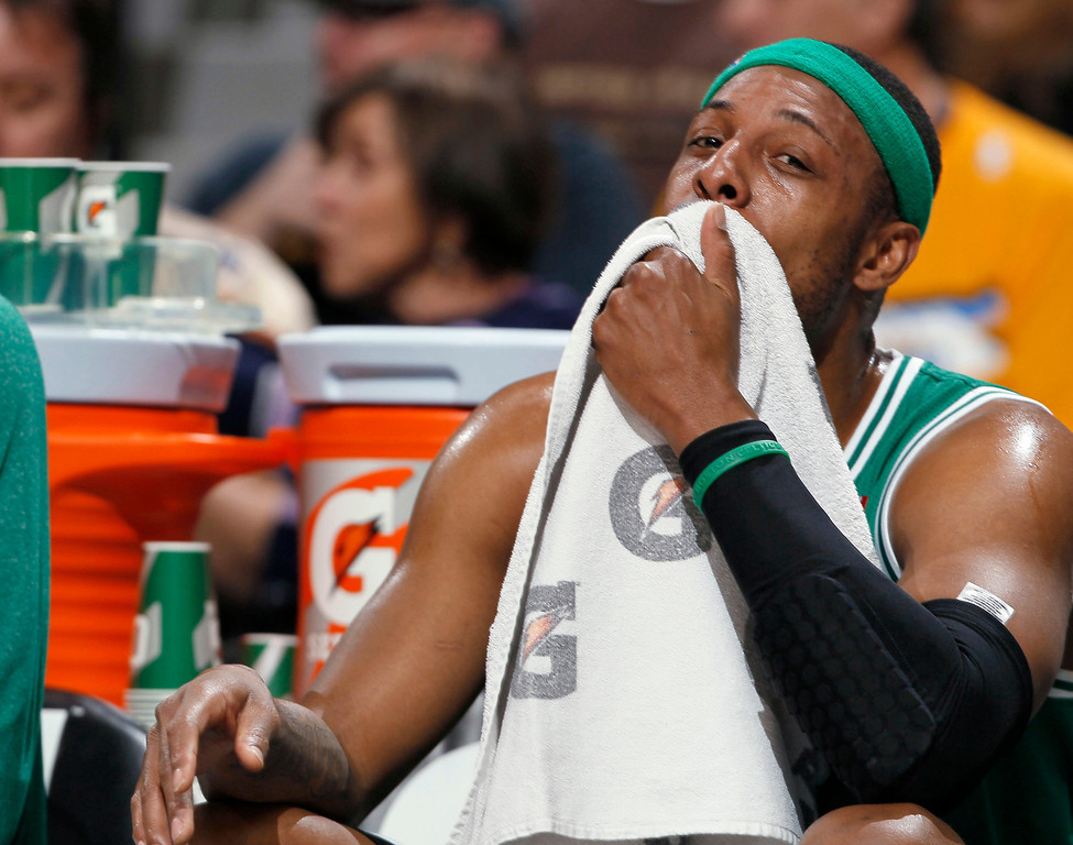 . Boston Celtics forward Paul Pierce takes a seat on the bench during the first quarter of an NBA basketball game against the Denver Nuggets in Denver on Tuesday, Feb. 19, 2013. (AP Photo/David Zalubowski)