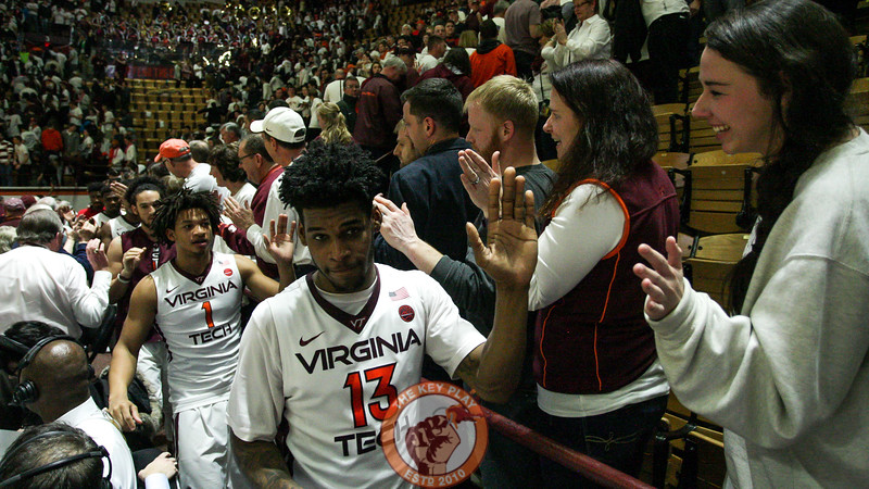Ahmed Hill high fives fans on the edges of the court after the game. (Mark Umansky/TheKeyPlay.com)
