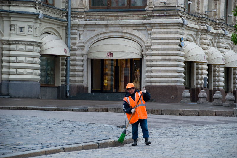 Woman cleaning a Red Square