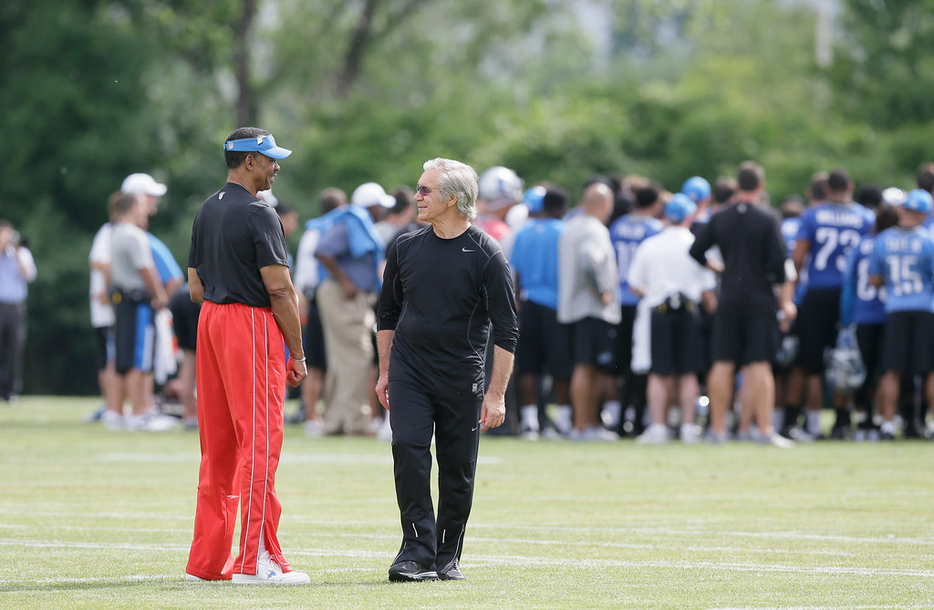 . Detroit Lions Assistant Director of Pro Personnel Charlie Sanders, left, and Senior Coaching Assistant -Gunther Cunningham are seen during an NFL football minicamp in Allen Park, Mich., Wednesday, June 11, 2014. (AP Photo/Carlos Osorio)