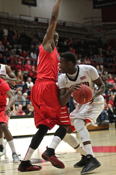 Donta Harper(0) hustles around his opponent to pass the ball.
