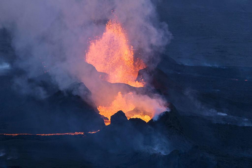 . An aerial picture taken on September 14, 2014 shows fire and smoke rising from the Bardarbunga volcano in southeast Iceland. The Bardarbunga volcano system has been rocked by hundreds of tremors daily since mid-August, prompting fears the volcano could explode. Bardarbunga, at 2,000 metres (6,500 feet), is Iceland\'s second-highest peak and is located under Europe\'s largest glacier, Vatnajoekull. BERNARD MERIC/AFP/Getty Images