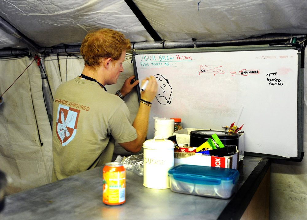 Description of . In this image released on January 22, 2013, Prince Harry drawing the shift brew person (who makes the tea all day) during his 12 hour VHR (very high ready-ness) shift at the British controlled flight-line at Camp Bastion on November 3, 2012 in Afghanistan. Prince Harry has served as an Apache Helicopter Pilot/Gunner with 662 Sqd Army Air Corps, from September 2012 for four months until January 2013.  (Photo by John Stillwell - WPA Pool/Getty Images)