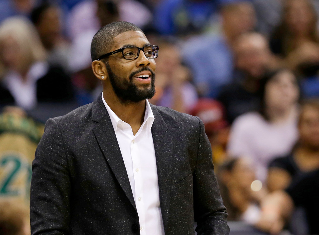 . Cleveland Cavaliers guard Kyrie Irving watches from the bench during the second half of an NBA basketball game between the Orlando Magic and the Cleveland Cavaliers, Friday, Dec. 11, 2015, in Orlando, Fla. Cleveland won 111-76.  (AP Photo/John Raoux)