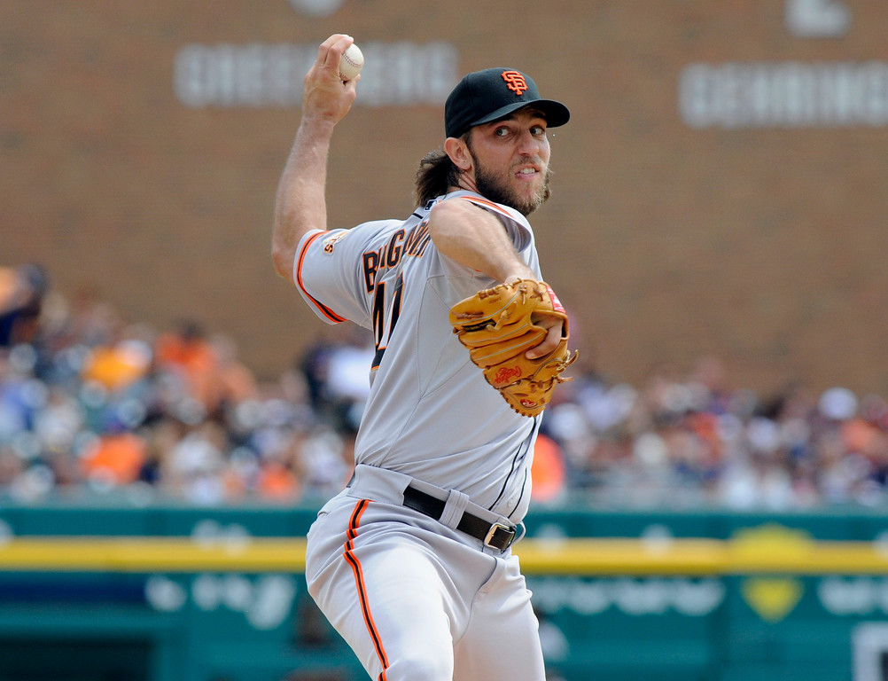 . San Francisco Giants pitcher Madison Bumgarner throws against the Detroit Tigers in the first inning of a baseball game Saturday, Sept. 6, 2014, in Detroit, Mich.  AP Photo/Jose Juarez)