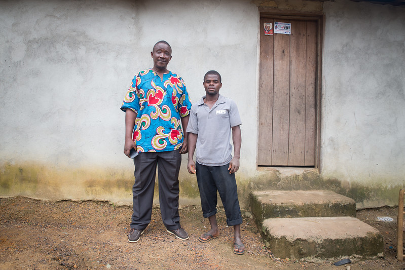 Monrovia, Liberia October 8, 2017 - Boimah Dorley (right), worked with Victor Tuazama of the Carter Center CJA to settle a debt dispute that involved police and possible jail time.