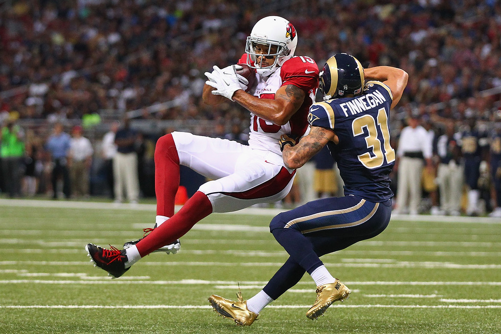 . Michael Floyd #15 of the Arizona Cardinals catches a 44-yard pass against Cortland Finnegan #31 of the St. Louis Rams at the Edward Jones Dome on September 8, 2013 in St. Louis, Missouri.  (Photo by Dilip Vishwanat/Getty Images)