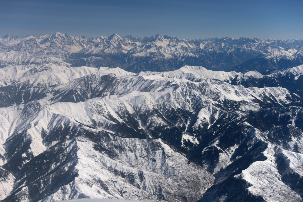 . Snow-capped Himalayan mountains in the Kashmir region are pictured during a commercial flight from Jammu to Srinagar on January 22, 2013. The Kashmir valley continues to shiver as minimum temperatures in the region plummeted several degrees below freezing, a local report said.  TAUSEEF MUSTAFA/AFP/Getty Images