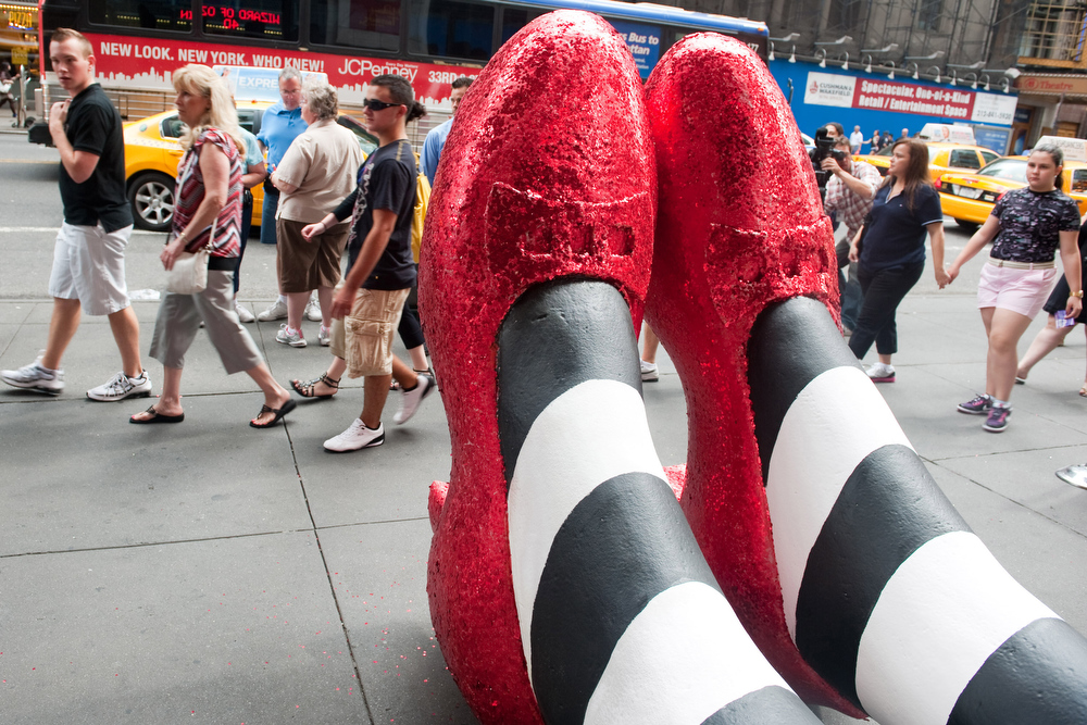 Description of . Six-foot tall ruby red slippers are unveiled on 42nd Street outside of Madame Tussauds to celebrate the launch of The Wizard of Oz Cinema 4-D Experience in New York, Tuesday, July 13, 2010. (AP Photo/Charles Sykes)
