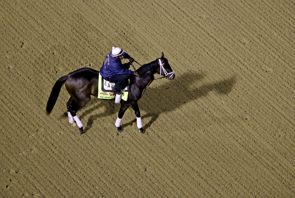 . Exercise rider Nick Bush takes Kentucky Derby entrant We Miss Artie for a morning workout during a morning workout at Churchill Downs Friday, May 2, 2014, in Louisville, Ky. (AP Photo/Charlie Riedel)
